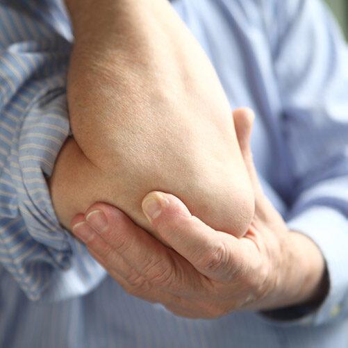 Close-Up-Elbow-Pain.jpg